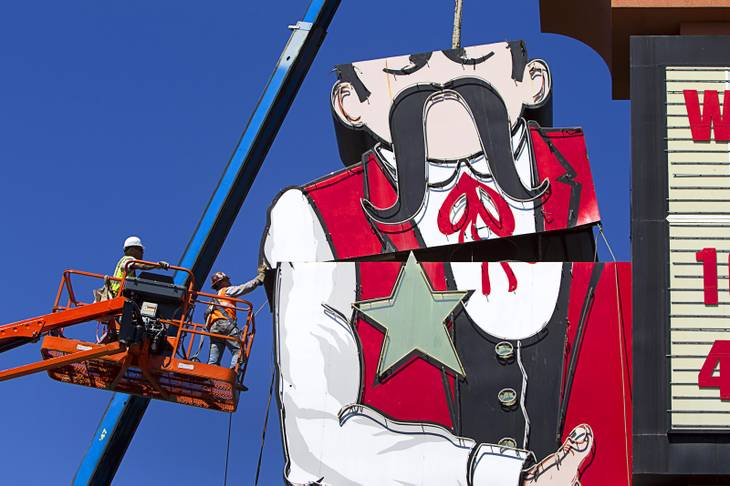 Workers take down the Terribles Cowboy signage at Terribles Hotel & Casino, 4100 Paradise Rd., Monday, May 20, 2013. The property is being renamed Silver Sevens Hotel & Casino. The new name and signage is part of a $5 million renovation project by Affinity Gaming. The cowboy sign is being donated to the Neon Museum.