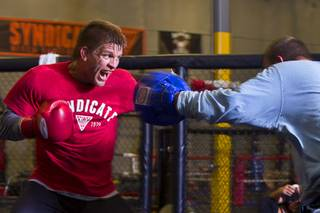 UFC welterweight fighter Mike Pyle, left, works on his timing with boxing coach Jimmy Gifford at the Syndicate gym Monday, May 20, 2013. Pyle will fight Rick Story at the MGM Grand Garden Arena Saturday.
