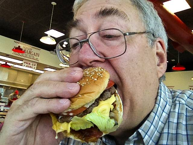 Tom Gorman enjoys a Five Guys burger.