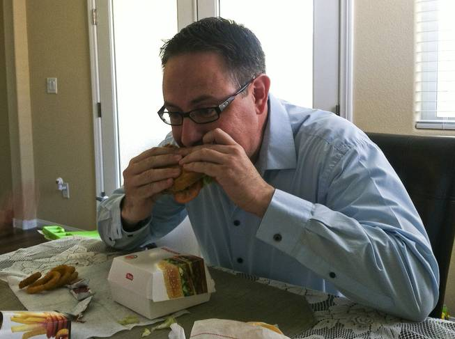 Ray Brewer enjoys a Whopper.