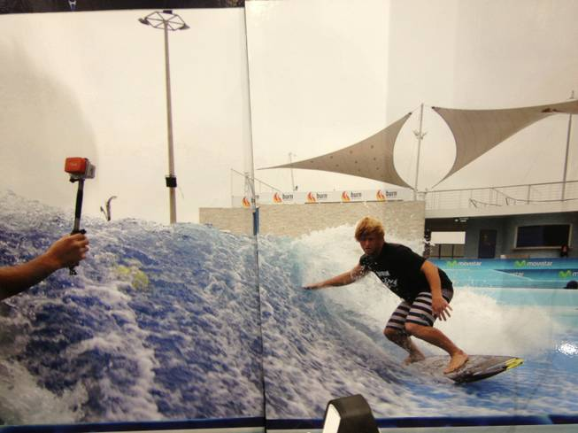American Wave Machines sells stationary machines that let people surf and body board in place. The company's booth at RECon, the retail industry trade show at the Las Vegas Convention Center, has a picture of a surfer using the machine. The picture was split on two display boards. The machines can be built in a range of sizes and typically cost between $300,000 and $5 million.