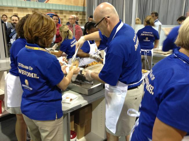 Auntie Anne's staffers make fresh pretzels to serve at RECon, the retail industry trade show at the Las Vegas Convention Center, on May 20, 2013. Company officials expect to serve 12,500 pretzels during the convention.