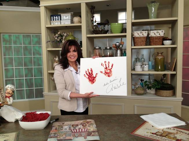 Marie Osmond with her Buca di Beppo hand prints in marinara.