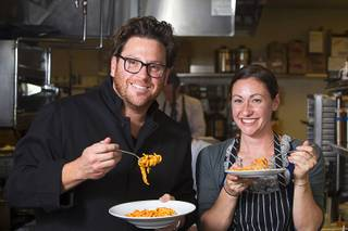 Chef Scott Conant and Las Vegas Weekly's Sarah Feldberg make spaghetti in the Scarpetta restaurant kitchen at the Cosmopolitan Wednesday, May 22, 2013.