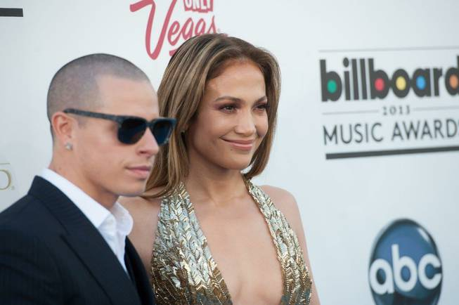 Casper Smart and Jennifer Lopez arrive at the 2013 Billboard ...