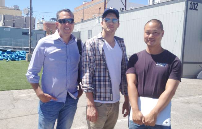 Zappos executive Fred Mossler, left, actor Ashton Kutcher, center, and Zappos CEO Tony Hsieh pause Thursday afternoon outside the Construction Zone speaker trailer near Seventh and Fremont streets. Hsieh was giving Kutcher a tour of many of the Downtown Project undertakings in the Fremont East Entertainment District.