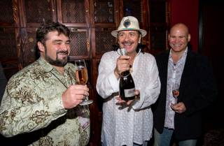 Carlos Santana and Mumm Napa launch Supernatural Rose at House of Blues Foundation Room at Mandalay Bay on Wednesday, May 22, 2013. Ludovic Dervin, winemaker for Mumm Napa, and Andrew Economon, GM of House of Blues and Foundation Room, joined Santana.