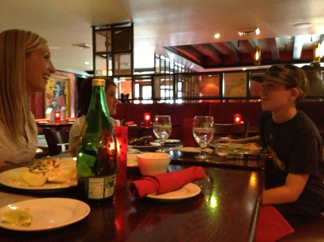 Firefly regular Heather Vaneks eat dinner at the new Firefly at Paradise on Friday, May 24, 2013, almost a month after the previous Firefly restaurant down the street was closed by heath inspectors over salmonella poisoning that sickened nearly 300 people.