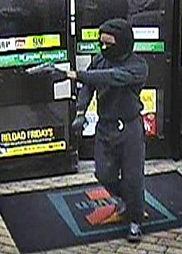 Metro Police released this image of an armed robbery suspect in a string of crimes they described as a black male adult, standing approximately 5 feet 8 and weighing 150 to 170 pounds.