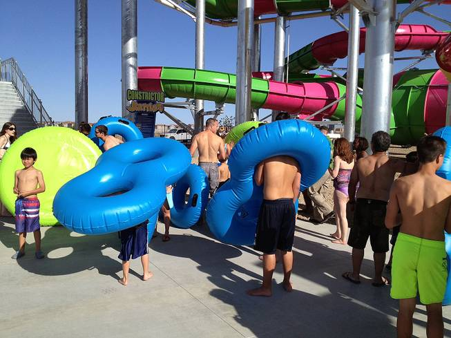 Lines for the ride extended to the bottom of the multiflight stairs as kids wait to try out the Constrictor and Rattler for the first time during the Wet 'n' Wild Las Vegas' grand opening on Friday, May 24, 2013. The day marked the first time the 41-acre water park on Fort Apache Road near the 215 Beltway was opened to visitors.