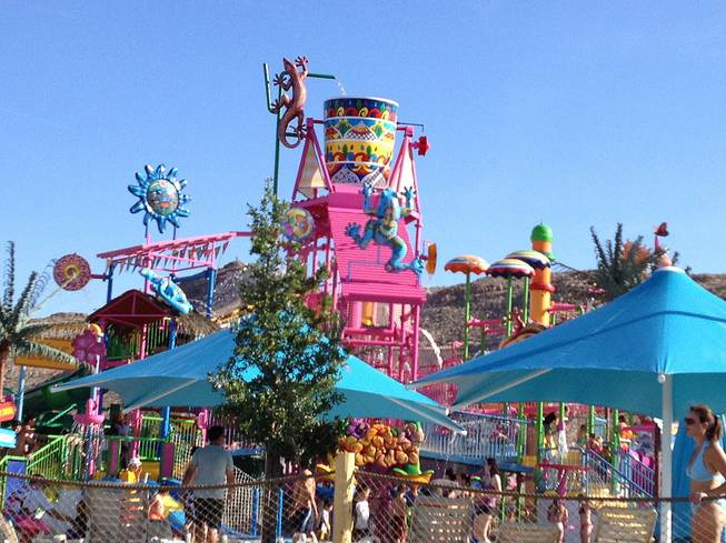 Youngsters run around in Wet 'n' Wild' children's fun area during the park's grand opening on Friday, May 24, 2013.
