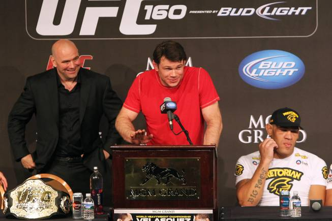 "Forrest Griffin announces his retirement after UFC 160 Saturday, May 25, 2013 at the MGM Grand Garden Arena. On the left is UFC president Dana White and on the right is heavyweight Antonio ""Bigfoot"" Silva."