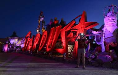 The junked signs that attracted throngs to old Las Vegas are once again glinting and shimmering at night.