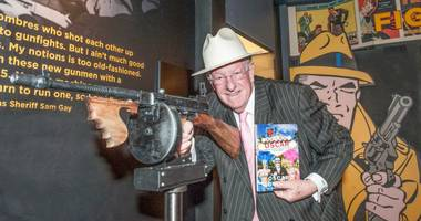 Former Las Vegas Mayor Oscar Goodman poses with a Tommy gun at The Mob Museum on Saturday, May 25, 2013.