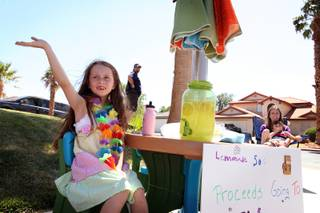 Gatlin Coleman, 7, sells lemonade to raise money for the Nevada Society for the Prevention of Cruelty to Animals outside her home on Sunday, May 26, 2013 in Henderson.