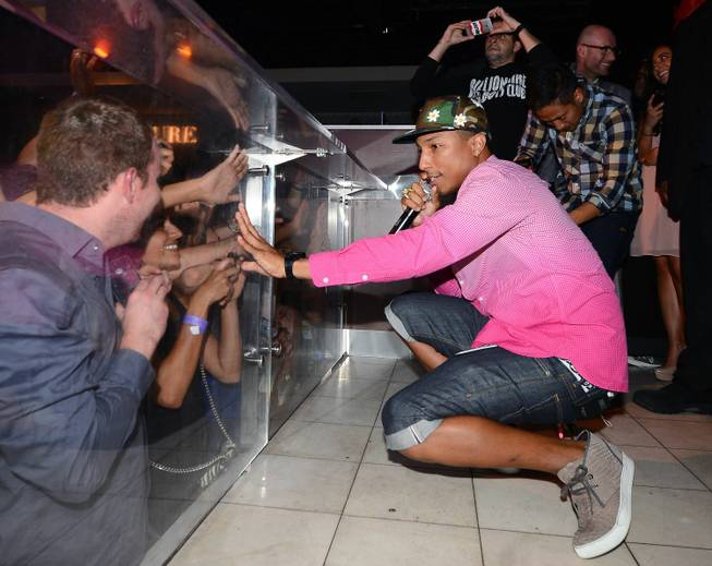 Pharrell Williams hosts and performs at Pure in Caesars Palace ...