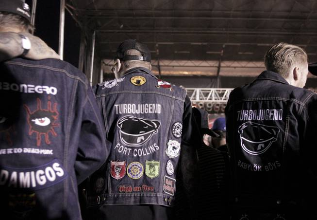 Turbonegro fans wear custom made jackets with the bands logo during the Punk Rock Bowling & Music Festival, Sunday, May 26, 2013.