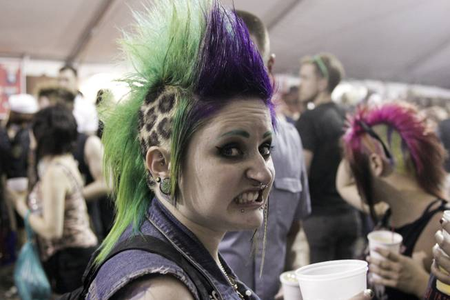 A fan with a colorful mohawk hangs out at the beer canopy at the Punk Rock Bowling & Music Festival, Sunday, May 26, 2013.
