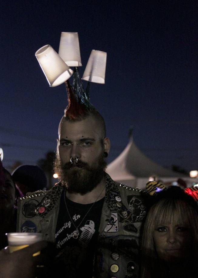 A fan customized his mohawk with empty plastic beer cups at the Punk Rock Bowling & Music Festival, Sunday, May 26, 2013