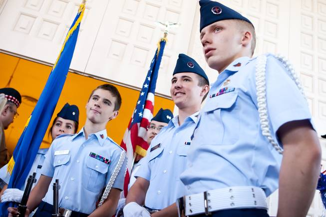The Las Vegas Composite Squadron Color Guard of the Civil Air Patrol prepares to present the colors during the 48th Annual Memorial Day Service at the Palm Downtown Mortuary and Cemetery in Las Vegas, Monday, May 27, 2013.