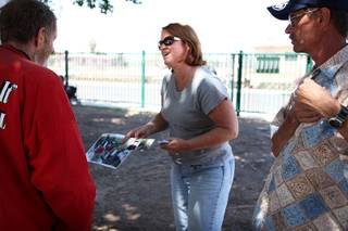 Virginia Fisher Murdoch, who lives in Florida, searches for her brother Kerry Fisher, whom she believes is homeless in Las Vegas, with the help of Neil Jurgensen, right, who recently left a life on the streets, on Owens Avenue in downtown Las Vegas on Monday, May 27, 2013. Murdoch hasn't seen her brother in more than 25 years.