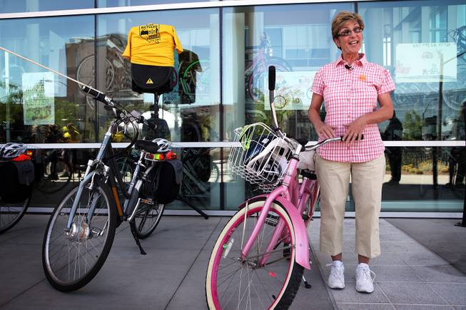 Clark County Commissioner Chris Giunchigliani shows off her pink bike after an educational press conference about safe bicycling on Thursday, May 30, 2013 at the RTC Bonneville Transit Center in downtown Las Vegas.