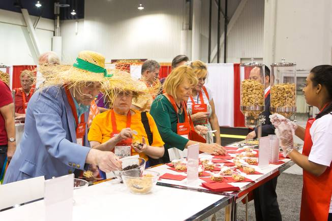 Conventioneers grab samples of Post Shredded Wheat during the 2013 AARP Convention on Thursday, May 30, 2013.