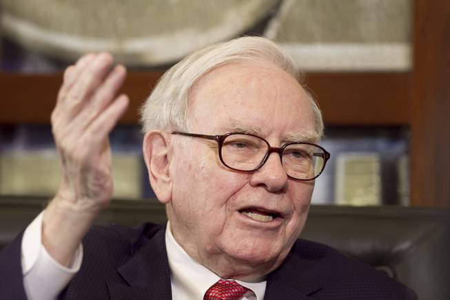 In this May 2, 2011, file photo, Warren Buffett, chairman and CEO of Berkshire Hathaway, gestures during an interview in Omaha, Neb.