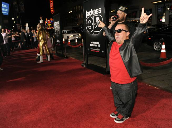 "Jason ""wee man"" Acuna, right, a cast member in ""Jackass 3D,"" poses at the premiere of the film in Los Angeles, Wednesday, Oct. 13, 2010, in Los Angeles."