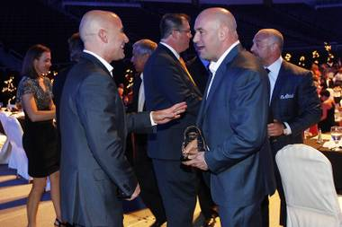 Inductees Andre Agassi, left, and Dana White talk during the induction ceremony for the Southern Nevada Sports Hall of Fame at the Orleans Arena Friday, May 31, 2013, at the Orleans Arena.