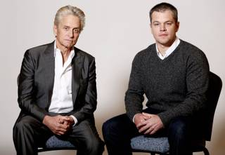 In this Jan. 4, 2013 photo, actors Michael Douglas, left, and Matt Damon, from the HBO film