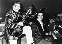"Liberace, the piano virtuoso who became known as ""Mr. Showmanship,"" is shown with Elvis Presley at the Riviera in Las Vegas in November 1956."