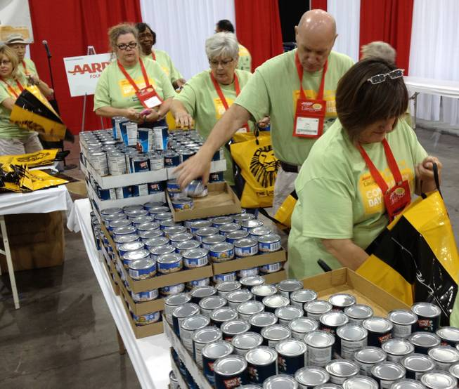 AARP members in Las Vegas for a convention pack meals for Three Square.