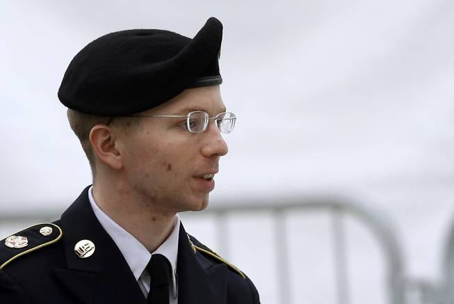 In this May 21, 2013, file photo, Army Pfc. Bradley Manning is escorted into a courthouse in Fort Meade, Md., before a pretrial military hearing.
