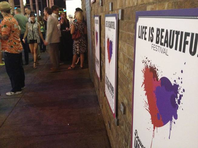 Posters for the Life Is Beautiful festival are shown outside Fremont Country Club, where the October event's music lineup was announced Monday, June 3, 2013.