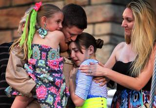 U.S. Air Force Capt. John Costa surprises his daughters by appearing at the end of the