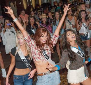 The 2013 Miss USA Pageant contestants compete in a line-dancing contest at Toby Keith's I Love This Bar & Grill in Harrah's on Tuesday, June 4, 2013.