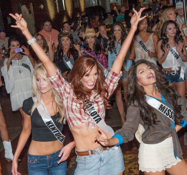 The 2013 Miss USA Pageant contestants compete in a line-dancing ...