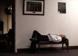 Nevada Assemblyman John Ellison, R-Elko, naps after lawmakers failed to meet their midnight deadline for the end of the 77th Legislative session in Carson City, Nev., Tuesday, June 4, 2013.