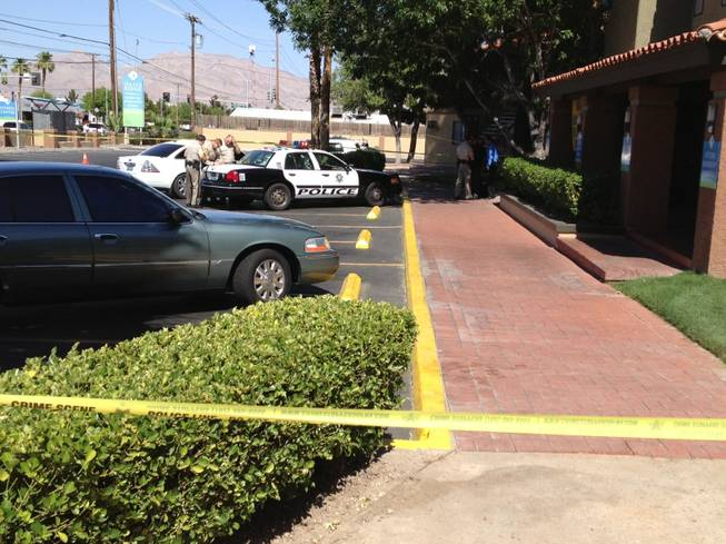 Metro Police investigate an officer-involved shooting Tuesday, June 4, 2013 at the Oasis Ridge Apartments complex, 3040 E. Charleston Blvd.