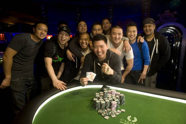 Benny Chen poses with his friends after winning the 2013 World Series of Poker Millionaire Maker tournament at the Rio on June 4, 2013.