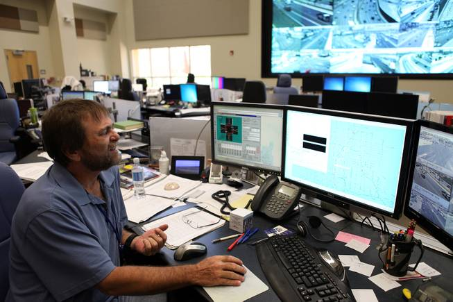 Ken Hutchens, a senior traffic engineering technician at the Freeway & Arterial System of Transportation (FAST) works inside their headquarters in Las Vegas on Thursday, June 6, 2013.