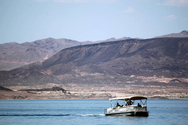 A pontoon boat is seen on Lake Mead Thursday, June 6, 2013.