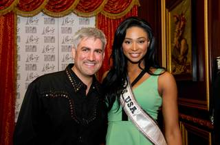 Taylor Hicks poses for a photo with Miss USA 2012 Nana Meriwether, following a concert at the Paris Las Vegas hotel in Las Vegas, Nevada on Saturday June 8, 2013.  She will spend the next week touring, filming, rehearsing, and making new friends while preparing to compete for the coveted Miss USA Diamond Nexus Crown. Tune in to the crowning moment LIVE on NBC starting at 9:00 PM ET on June 16th, 2013 from PH Live. HO/Miss Universe Organization L.P., LLLP.