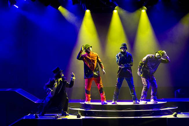 "Jabbawockeez cast members perform in ""Prism,"" their new show at the Luxor, Sunday, June 9, 2013."