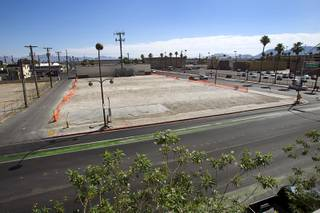 A vacant lot is shown at Ogden Avenue and Sixth Street in downtown Las Vegas Monday, June 10, 2013. The lot, owned by Alonzo Williams Sr., a 62-year-old medical doctor from Little Rock, Ark., was being used for parking but has recently been fenced off.