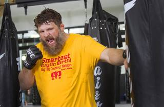 UFC heavyweight and Cimarron-Memorial grad Roy Nelson hits a bag at Gold's Gym, 7501 W. Lake Mead Blvd., Monday, June 10, 2013 in this file photo.