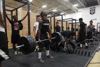 Football players use new equipment in the weight room at Chaparral courtesy of an anonymous donor Tuesday, June 11, 2013.