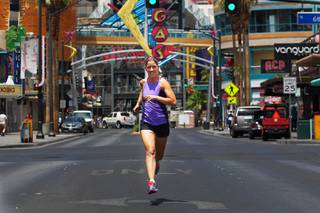 Tanya Carrier, seen downtown Tuesday, June 11, 2013, is a runner who is organizing new 5K fun runs for Las Vegas.