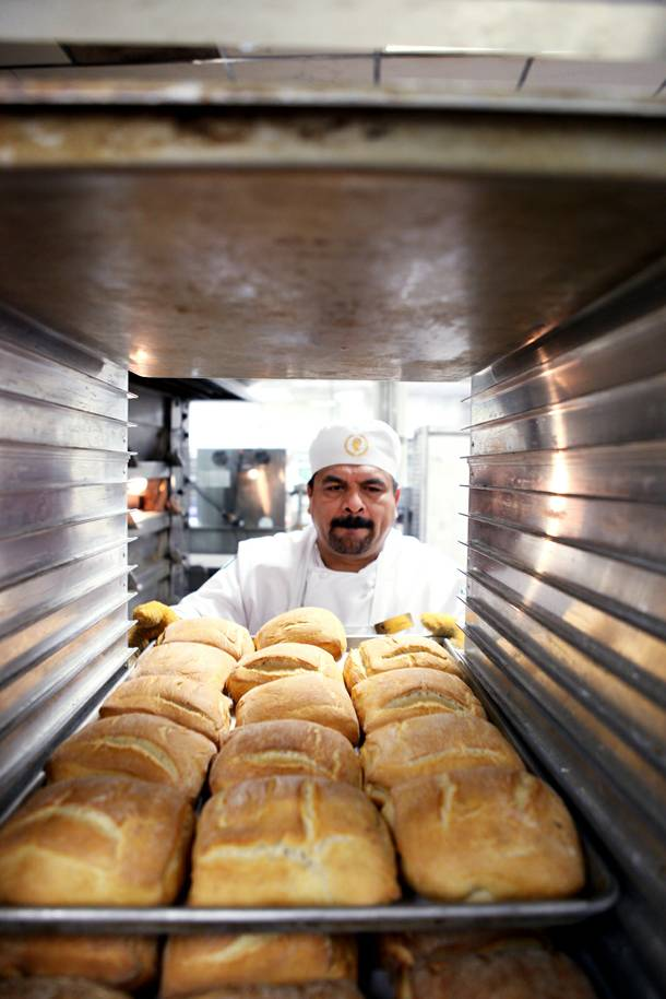 Baker Carlos Meza racks fresh bread inside the basement bakery at Caesars Palace in Las Vegas on Tuesday, June 11, 2013.